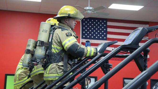 Ryan Mayes, a driver at Amarillo Fire Station 7, was among the AFD firefighters wearing full gear and participating in a 9/11 Memorial Stair Climb, climbing the equivalent of 110 floors representing the 110 floors of the World Trade Center, whose towers were destroyed in the Sept. 11, 2001, terror attacks on the United States. The event was hosted by Gold's Gym Friday morning.