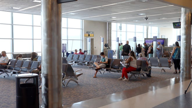 Passengers wait their turn to board a Southwest Airlines flight from Rick Husband Amarillo International Airport.