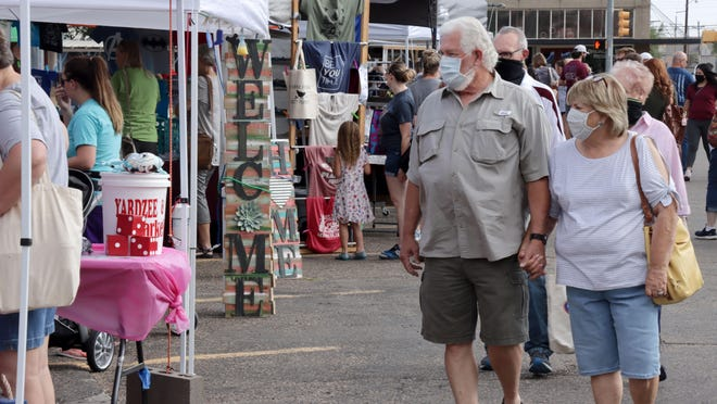 Joe and Glenda Hutcherson enjoyed the weather as they walked around the opening day for the annual Canyon Farmers' Market June 27.