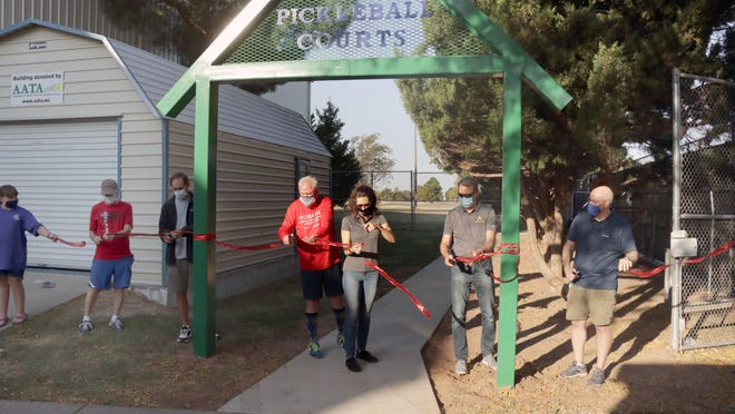 City officials, community members as well as pickleball enthusiasts cut the ribbon for the Amarillo National Tennis Center's nine new pickleball courts Saturday morning.