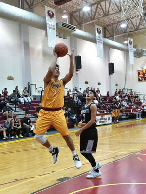 Father Duenas player Kyle Gaitan (1) fades away for a shot against a Simon Sanchez defender during their Independent Interscholastic Athletic Association of Guam Boys Basketball game at the Father Duenas Memorial School Phoenix Center in Mangilao on Feb. 14, 2017. The Friars won the contest 52-35.