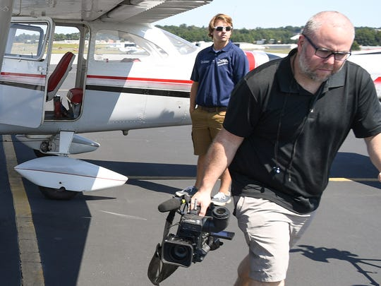 Aaron Smeltzer, right, films at the Greenville Downtown Airport during evacuation of animals from Charleston to AnMed Hospital in Anderson in September 2017.