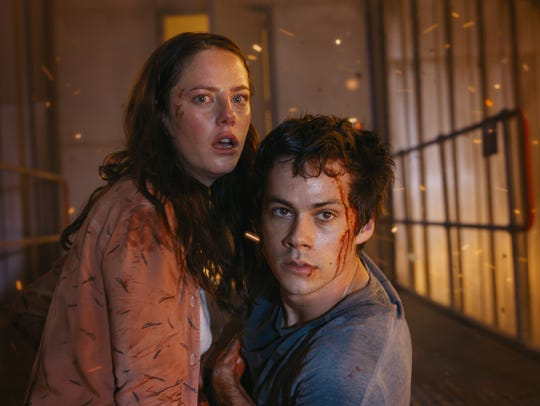 Teresa (Kaya Scodelario) and Thomas (Dylan O'Brien)
