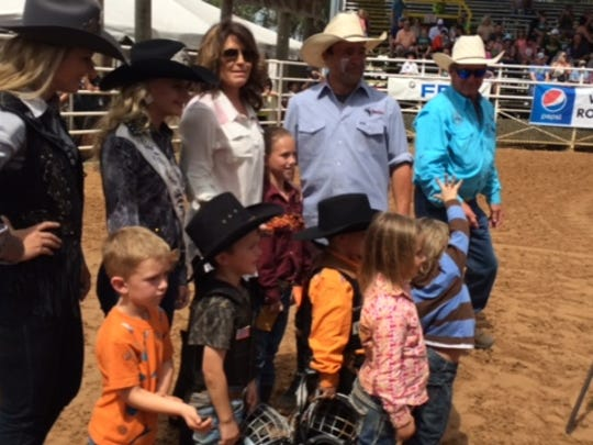 Palin posed with children who took part in a sheep-riding contest at the Arcadia Rodeo.