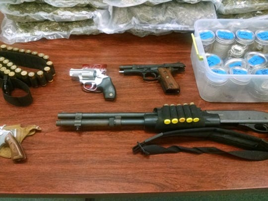 Police seized numerous guns and ammunition from Richard Johnson's home.