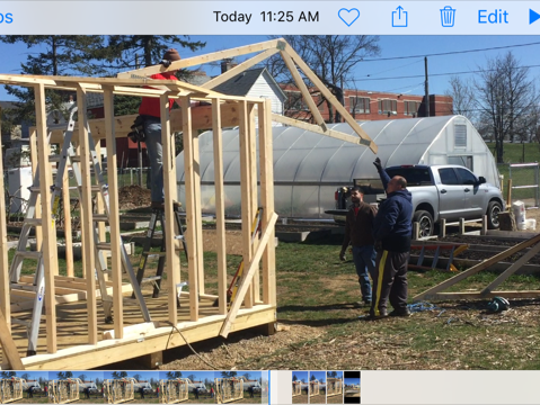 The Blust Avenue Teaching Garden Tuesday received a new shed from Lowe's Heroes program. Employees are building six new raised garden beds next week at the site. Lowe's employee Neil Conn lifts a truss up to a coworker.