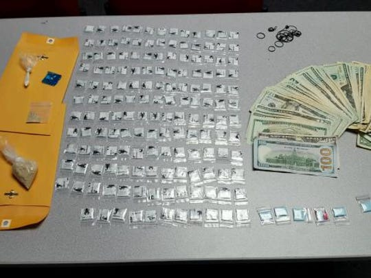 Dover police found heroin, crack cocaine, marijuana and suspected drug proceeds inside the vehicle.