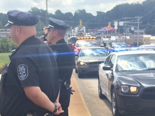 Members of the Gastonia Police Department pay respects