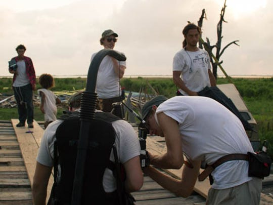 "Director Benh Zeitlin checks a shot on the set of his award winning movie ""Beasts of the Southern Wild."""