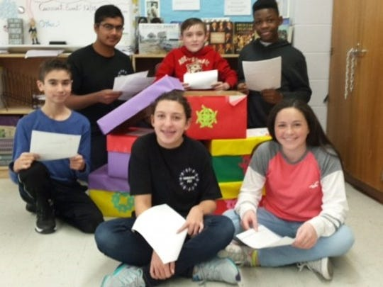 Clockwise from top right: Bashler Luxeus, Eliza Cashman, Taylor Obdyke, Michael Blumstein, Yash Kolhatkar and AJ Silvestri look over some letters collected in an effort to raise funds for the Make-A-Wish Foundation.