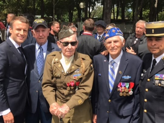 French President Emmanuel Macron poses with Evansville resident and WWII veteran Donald Cobb and other veterans who survived D-Day.