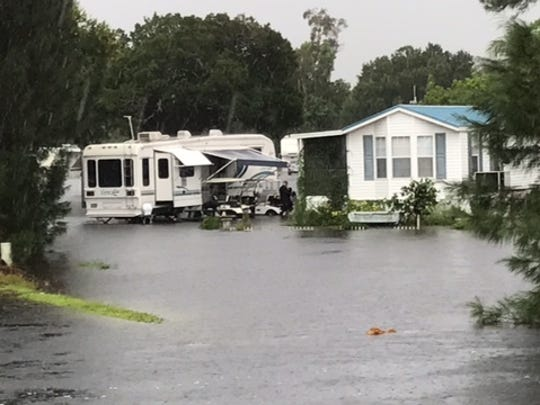 Manufactured homes are surrounded by water that overflowed a nearby drainage swale and 10 Mile Canal, which abuts the resort.