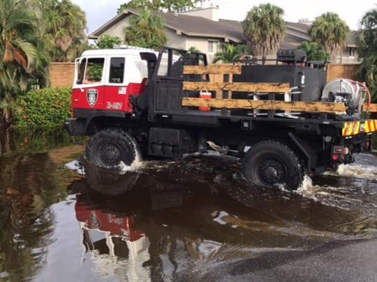 Flooding along Island Park Drive in San Carlos Park.