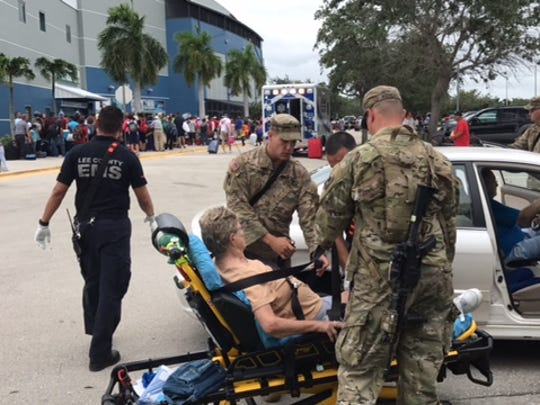 National Guard members are on hand at Germain Arena in Estero helping evacuees enter the shelter.