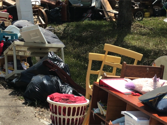 Residents along Shady River Lane in Buckingham line their street with belongings that were damaged when the Orange River overran its banks on Sunday during Hurricane Irma.