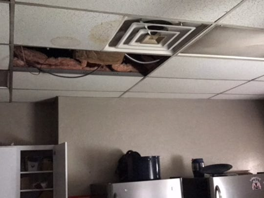 Ceiling tiles were soaked by roof leaks from the rains