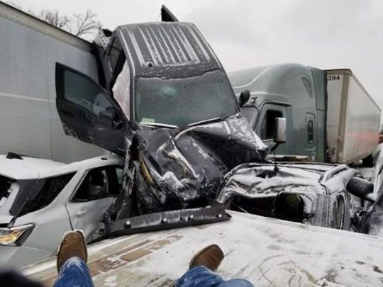 A truck rests on top of a semi-truck at an accident on Interstate 44 in Rolla, Missouri.