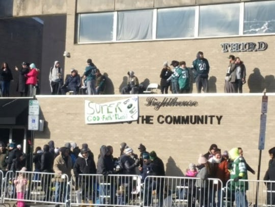 Fans take over the roof of a South Philly Baptist church