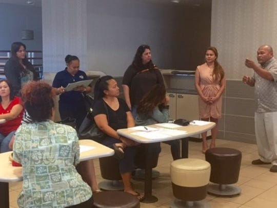 """Guam Education Board Chairman Mark Mendiola, right, addresses the parents of Chief Brodie Memorial Elementary School Thursday night during a Parent-Teacher Association meeting at McDonald's Harmon to talk about what the PTA described as a """"proposal to close down CBMES."""" Mendiola echoed Superintendent Jon Fernandez's statements that there is no final decision on any of the schools. Parents said the sooner they know about options such as closure or conversion of the school, the better, so they can prepare their children. Parents also said they are prepared to present options other than closing Chief Brodie."""