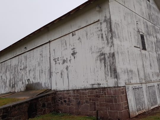 A barn that sits on 49 acres purchased by Dover Township