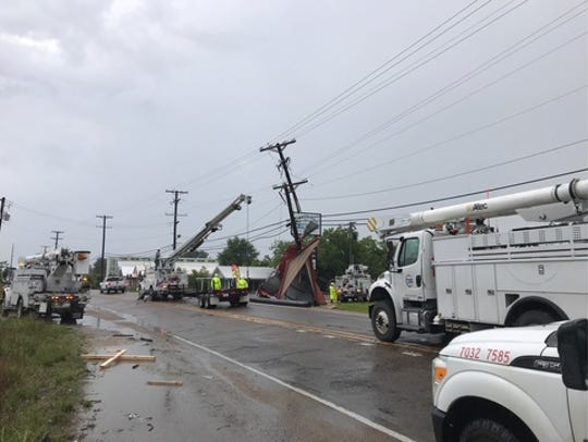 Power lines were down along Cameron Street near Ambassador