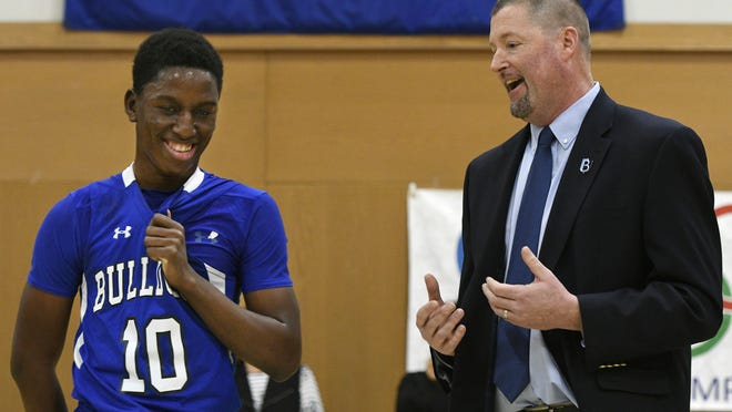Former Bancroft School basketball star Emmanuel Bangandozou, left, listens as his coach, Mark O'Brien, makes a speech in honor of him scoring his 2,000th point on Feb. 1, 2017. Earlier this week, Bangandozou remembered O'Brien, who died suddenly on Monday.