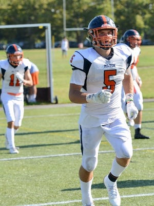 Milton Academy star Mitch Gonser (No. 5) was one of 33 players across the state to be named a National Football Foundation Scholar-Athlete. He will continue his playing career at Harvard. Photo courtesy of Milton Academy/Mort Fearey