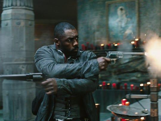 """Have guns, will travel for Roland Deschain (Idris Elba) in """"The Dark Tower."""""""