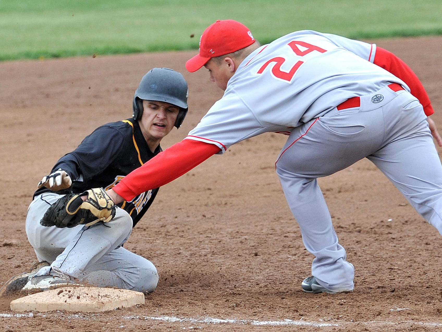 Colonel Crawford's Jake Johnson slides into third base before Buckeye Central's Trent Craft can tag him out during their game Thursday evening.