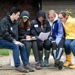 """Envirothon participants Sam Sheils, Kealey Shyk, Molly Gundermann, Josie Stoval, and Shannon Carmo, of Palmyra confer while answering questions. Lebanon County high school students descended on Levitz park in East Hanover Township to participate in the 32nd annual high school Envirothon. Envirothon is a hands on event that challenges students to think critically about the natural world and their role in it. Students are tested in the areas of aquatics, forestry, wildlife, and soils. The winners of the 32 Annual Lebanon County High School Envirothon for the third year in a row were Palmyra's, """"Envirovengers"""". They scored 447 points out of a possible 500."""