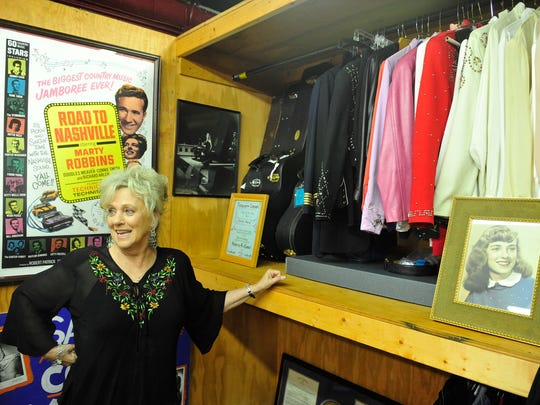 Connie Smith shows her memorabilia from over the years at her office at Marty Stuart Tours Inc. in Hendersonville.