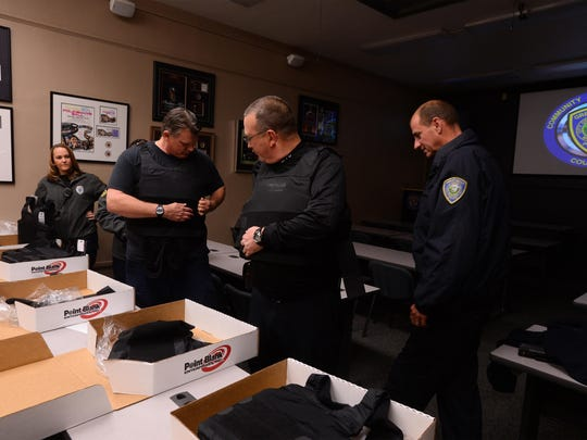 Three animal control officers and two traffic investigators try on the new body armor presented to them by the Exchange Club of Great Falls on Tuesday morning.
