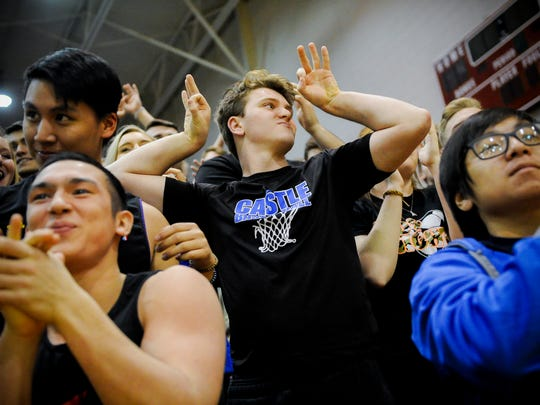 Castle senior Nick Ciuffetelli, 18, center, reacts during a game against Bosse at Bosse High School in Evansville, Tuesday, Feb. 2, 2017. Ciuffetelli is considered one of the unofficial leaders of the Castle student section.