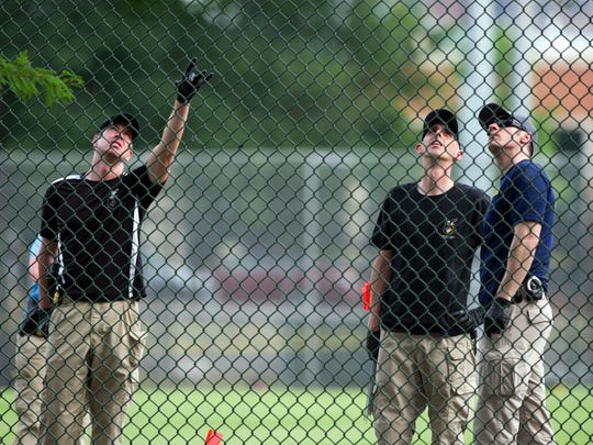 A FBI Evidence Response Team looks for evidence on the baseball field in Alexandria, Va., Wednesday, June 14, 2017, after a rifle-wielding attacker opened fire on Republican lawmakers at a congressional baseball practice, wounding House GOP Whip Steve Scalise of Louisiana and several others as congressmen and aides dove for cover.