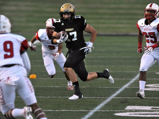 Abilene High School wide receiver Wes Berry tries to