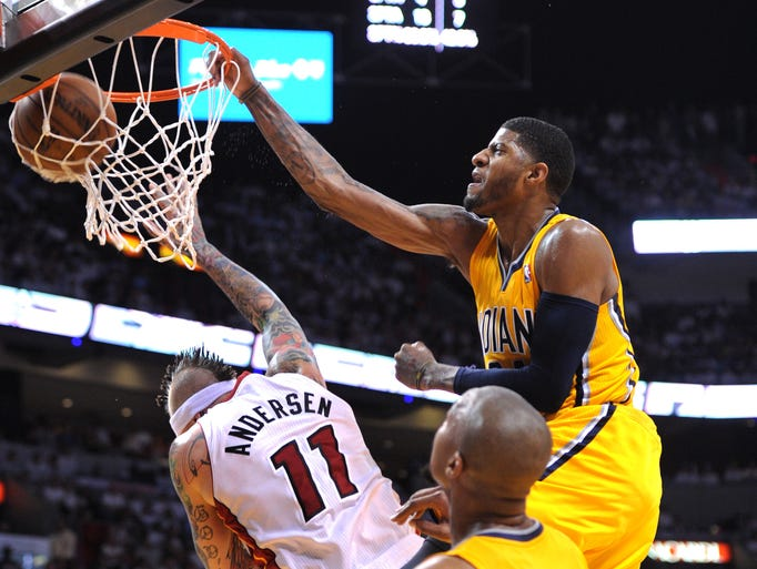 Pacers Paul George slams the ball home as the Heat's Chris Anderson tries to avoid the ball during the play.   Indiana Pacers vs. Miami Heat in game two of the Eastern Conference Finals May 24, 2013, at the American Airline Arena in Miami FL.