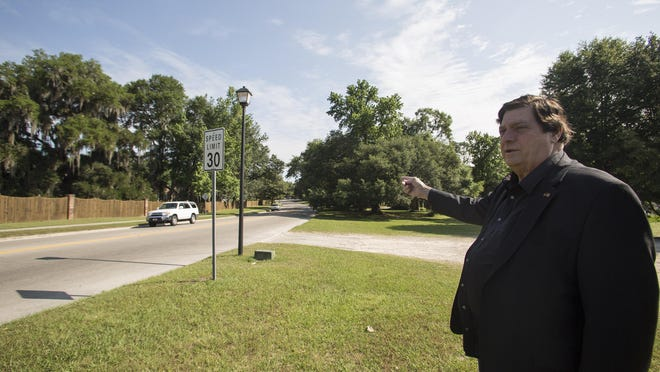 Killearn Homes Association President, John Paul Bailey, stands near the entrance of Shannon Lakes Park. Based on the FDOT's proposed option to four lane streets in the Killearn community a good portion of the park would be lost to development.