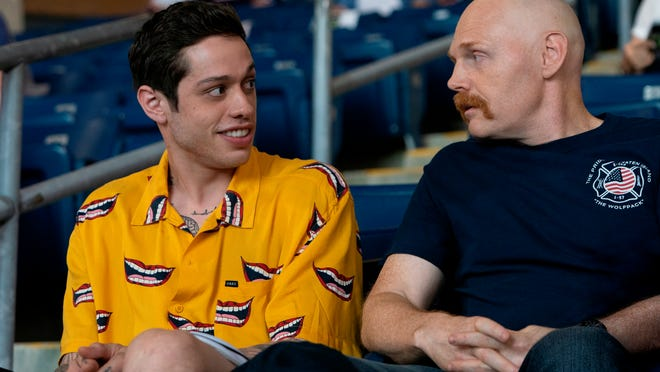 "Pete Davidson and Bill Burr in ""The King of Staten Island."""