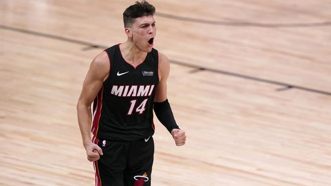 Miami Heat guard Tyler Herro celebrates a basket against the Boston Celtics late in the second half of Game 4 Wednesday night. Herro scored 37 points and the Heat beat the Celtics 112-109 to take a 3-1 series lead in the Eastern Conference Finals.