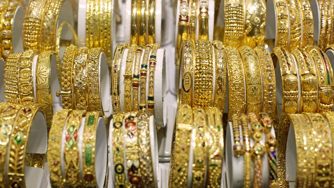 Gold bracelets sit in a display cabinet at a jewelry store in Jakarta, Indonesia, in this 2013 file photo.