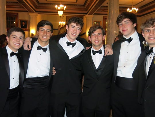 Jack McCrery, Jack Smith, Alex McJunkins, Logan Reeder, Jack Batson, Marshall McCurdy huddle up for a photo op at the Plantation Ball.