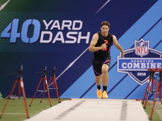 Wyoming quarterback Josh Allen runs the 40-yard dash during the NFL football scouting combine, Saturday, March 3, 2018, in Indianapolis. (AP Photo/Darron Cummings)