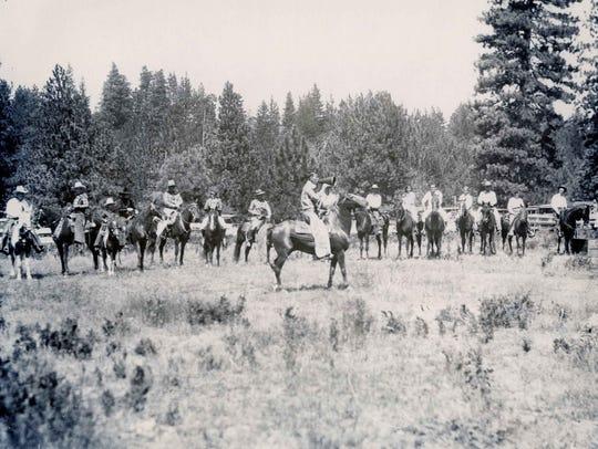 Summer horseback riders on the shore of Lake Arrowhead.