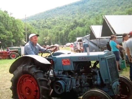 Frank Johnson on his 1936 Case tractor at one of his