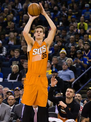 Dec 3, 2016: Phoenix Suns forward Dragan Bender (35) scores a three point basket against the Golden State Warriors during the fourth quarter at Oracle Arena. The Golden State Warriors defeated the Phoenix Suns 138-109.