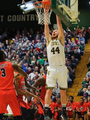 Vermont's Nate Rohrer (44) dunks the ball during the men's basketball game between the Stony Brook Seawolves and the Vermont Catamounts at Patrick Gym on Saturday afternoon January 13, 2018 in Burlington.