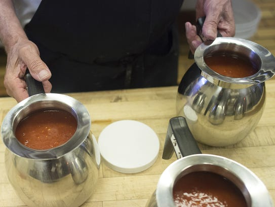 Frank Perez fills pitchers with salsa at Pobre Pancho's
