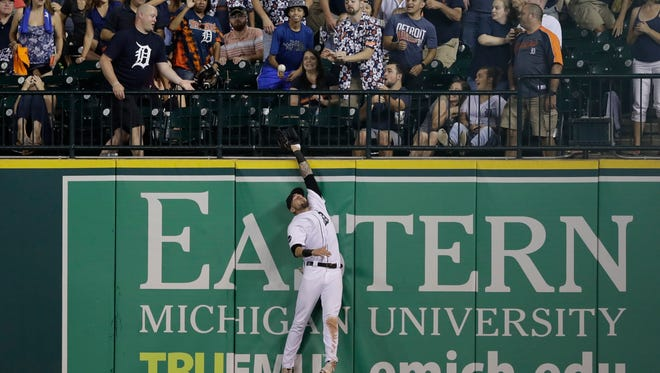 Tigers rightfielder Nick Castellanos can't reach the three-run home run hit by the Twins' Zack Granite in the eighth inning of the Tigers' 10-4 loss Saturday, Sept. 23, 2017 at Comerica Park.
