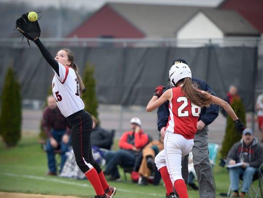 Annville-Cleona's Sarah Fischer pulls down a throw