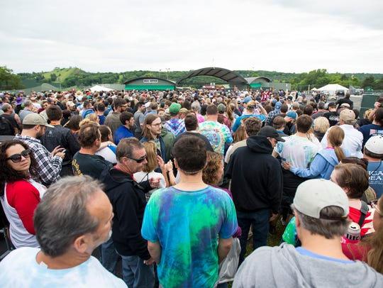 Fans wait in line June 22, 2018, to enter the gates at the Alpine Valley Music Theatre for Dead & Company, a Grateful Dead spinoff featuring John Mayer. The band also played the East Troy amphitheater June 23.